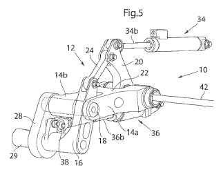 Disposición para controlar un volante tensor de la banda de rodamiento de un vehículo oruga.