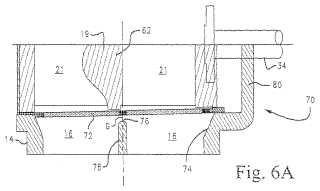 Orificio de descarga de baja presión no obstruido y rejilla-pantalla alargada para un alimentador de alta presión.