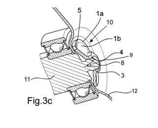 Dispositivo de fijación, máquina lavadora con dispositivo de fijación y procedimiento de fabricación de dispositivo de fijación.