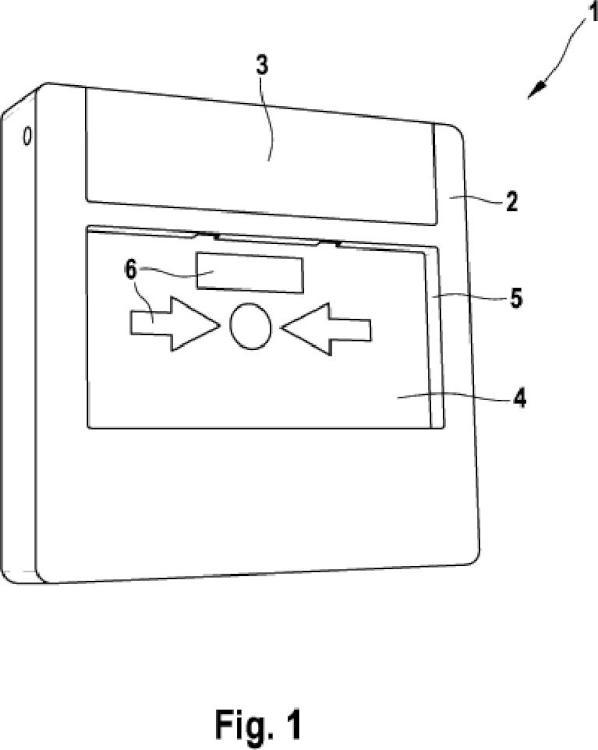 Dispositivo de aviso con mecanismo de prueba y llave especial para accionar el mecanismo de prueba.