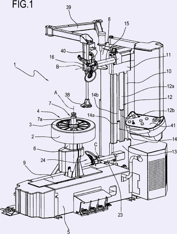 Máquina y procedimiento para montar y desmontar un neumático.