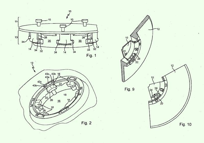 Sistema de acoplamiento de un disco de cepillo o de un plato de accionamiento de almohadilla.
