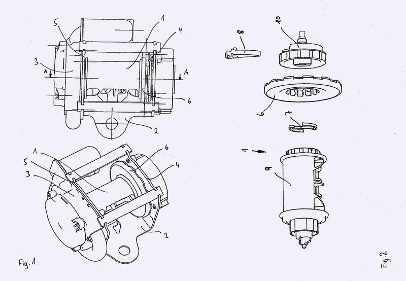 Tambor de arrollamiento de cinturón con dos dispositivos de limitación de fuerza que actúan en paralelo.