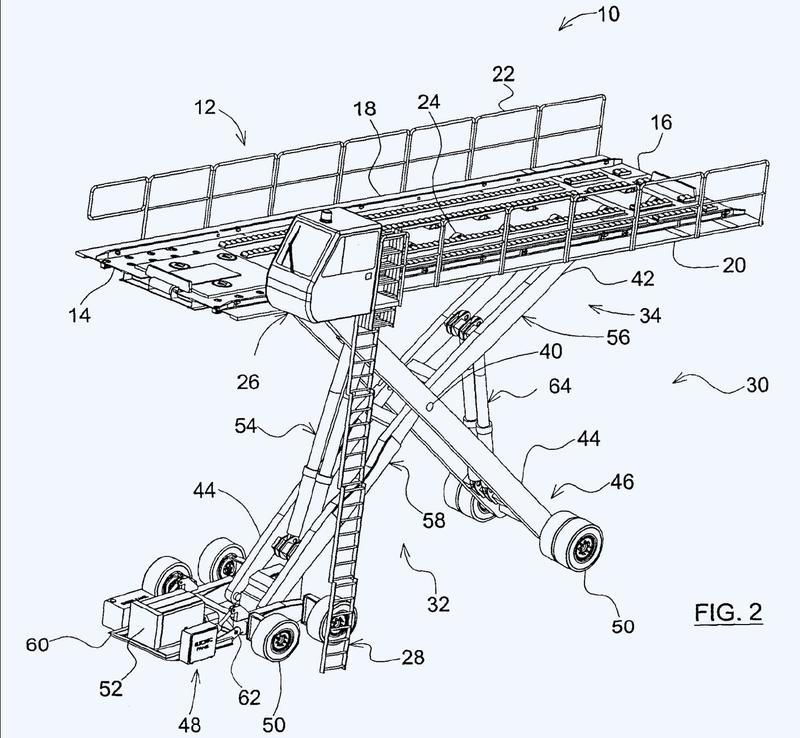 Cargador de carga para una aeronave con un conjunto de tijera articulada.