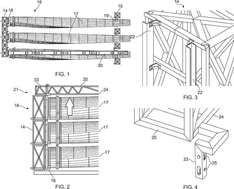 Sistema y método para transportar y elevar una pala de rotor de una turbina eólica.