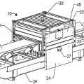 Ilustración 1 de Conjunto de analizador de material a granel que incluye vigas estructurales que contienen material de protección de radiación.